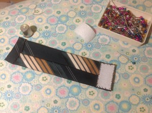 Add the Velcro to your tie. Remember one piece goes on the top of the fabric and one underneath on the opposite end